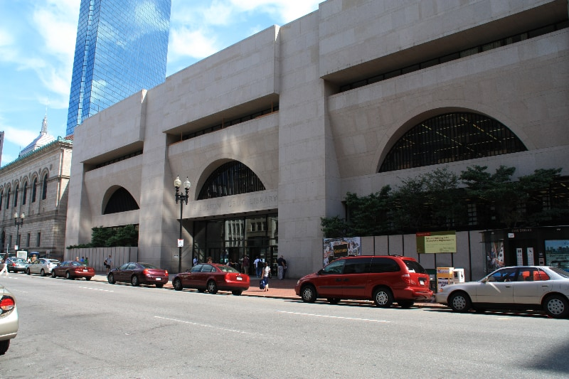 The Central Branch of the Boston Public Library is comprised of two buildings.  The modern building on the right here is the Johnson building.  It is the main entrance to the library; the Boston Marathon ends just outside its doors.  The historic McKim building is in the background of this photo.  The library conducts tours of the art and architecture in the McKim.  Photo Courtesy of Boston Public Library.
